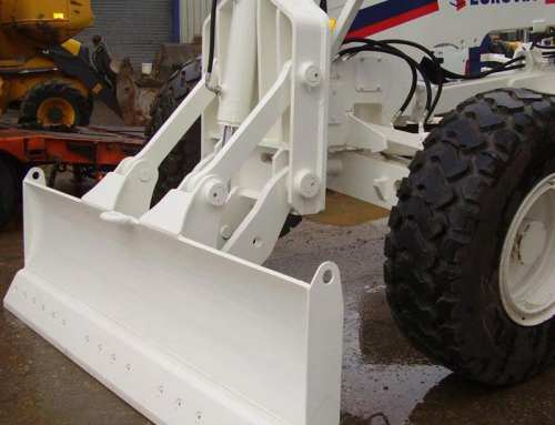 Front blade for grader with parallel kinematics